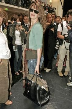 8621ac893e0e Jane Birkin with a Birkin bag at the Jean Paul Gaultier Spring Summer 2005  fashion show.