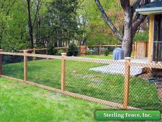 California Chain Link Fence. Chain link with wooden posts. Such an interesting look for a backyard fence and more affordable than am all wood fence. Love this combination of styles!