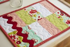 Placemat (mini-quilt) in case I ever get brave enough to try quilting.  So pretty and a less intimidating way to start.