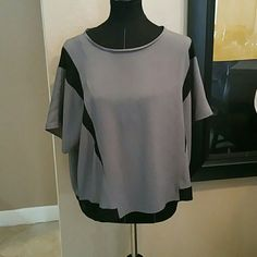 Michael by Michael Kors Top Light and airy, perfect with jeans and leggings. No rips,snags or holes. Barely used. Worn only a handful of times and dry cleane. Well stored and maintained. Smoke free home. MICHAEL Michael Kors Tops