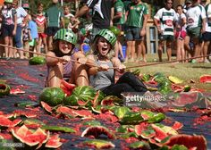 Anna Booth and Evelyn Peter take part in the water melon skiing event during the biennial Chinchilla Melon Festival on February 14, 2015 at Chinchilla in the Darling Downs region of Queensland,...
