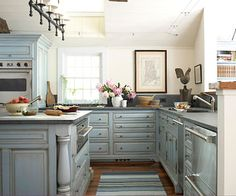 Classic Country Rooms: From tried-and-true blue-and-white palettes to vintage collections and creative repurposing, country decorating never goes out of style. Choose from a variety of lived-in, cozy looks and add comfort to every room of your house. By Andrea Cooley. Built-In Style:   The kitchen is the heart of the home, but it still needs to be a hardworking space. Custom cabinets offer stylish storage for all your cooking and entertaining needs. These furniture-style cabinets are the highlight of this kitchen with their pretty antique blue finish, turned feet, and built-up moldings. The space has all the modern amenities but is right at home in a classic farmhouse.