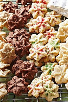 This is it! The traditional spritz cookie recipe that will remind you of winter nights at Grandma's house. These butter spritz cookies can easily be adapted to your favorite holiday flavors: chocolate, peppermint, or nutty. #spritzcookies #bestspritzcookies #christmascookies #bhg