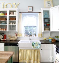 Love this colorful and bold kitchen! The whole house is incredible and comfy looking!