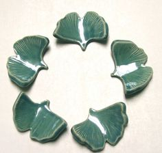 Set of five stoneware chop stick rests. Robins Egg Blue glaze Ginkgo Leaf. Complements most any sushi set. They have been glazed and high fired.