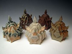 A series of wood fired boxes 6 inches tall by Lauren Young.