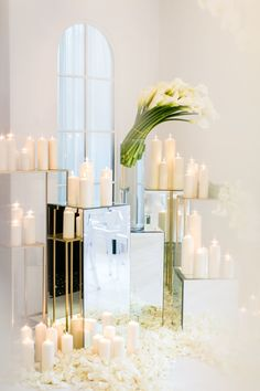 Candles on Modern Mirror Pedestals | Photo: Courtesy of White Lilac Inc.