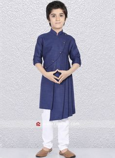This Designer kurta is highlighted with fancy button. It is made from Linen cotton fabric in Navy color is paired with White color trouser. #rajwadi #kidswear #boys #ethnic #traditional #modern #trendy #fashionable #kidsfashion
