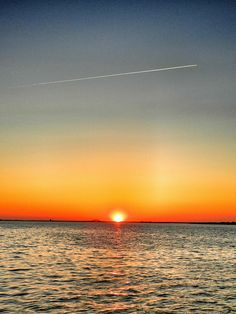 kismet, Fire Island NY sunset...with airplane stream!