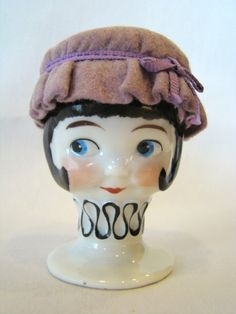 Do we think she has a ribbon under the cap?   Vintage 1920s GOEBEL Porcelain EGG CUP, Googly Eyed Girl, Felt Cap, Bee Mark