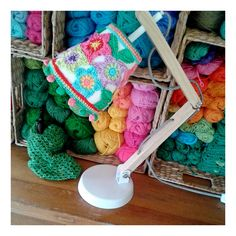 This is actually a page devoted to a pattern for the sweet, little stars on the lamp shade. I'm really digging that yarn storage in the background, though!