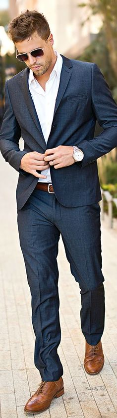 I often wear suits without a tie - work or out on the town. I like this style because it's sharp but not stuffy. On a Saturday night it's not unusual for me to be at an event, so I often will wear something similar. Most guys will either have a suit on or standard dress clothes, so I like to be a bit unique in this category.: