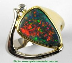 2.4 ct. Lightning Ridge Black Opal in 18K - now THAT is some fire.  Love the red.