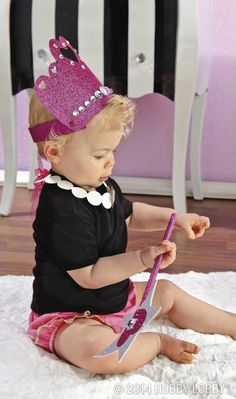 You know how to do a dress up day right—with accessories made from glitter fabric! Just cut out simple shapes, and embellish with gemstones. Crown: Attach back strap with hand-glittered brads. Necklace: Punch a hole at each end, and knot on two ribbons for a closure. Wand: Coat a dowel rod with loose glitter, and sandwich between layered cutouts.