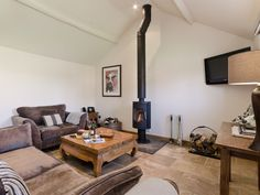 This large open plan living area has an eyecatching wood burner which is ideal for cosying up to on cold winter nights. Popular Woodworking, Woodworking Projects, Living Area, Living Spaces, Cosy Lounge, Wood Worker, Open Fires, Diy Bench, Open Plan Living