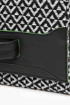 <ul> <li> Cotton and leather clutch bag</li> <li> Fold-over flap fastening</li> <li> Leather hand/wrist strap at front</li> <li> Interior card holder</li> <li> Approximate measurements: height - 15cm, width - 26.5cm</li> </ul>