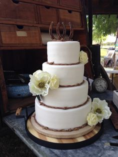 Country Wedding! Layers of lemon & strawberry cake iced with cheesecake flavored butter cream frosting. Handmade fondant horse shoes and barbed wire.
