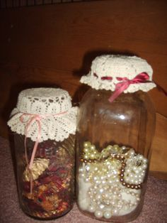 I took old canning jars found at yard sales and estate sale and filled with vintage keepsakes such as my grandmother's costume jewelry, and topped with doilies and ribbons. They look great on my bathroom shelf for an old fashioned look.