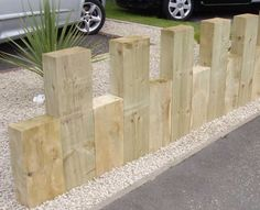 Low fence from railway sleepers