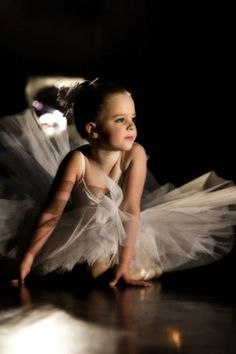 maybe this was taken in the wings of the stage...maybe this little dancer is watching her favorite dancer from there ;)