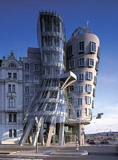 Frank Gehry, Casa danzante (dancing house), Prague - love this building! AKA the Fred & Ginger Building Futuristic Architecture, Amazing Architecture, Contemporary Architecture, Art And Architecture, Prague Architecture, Chinese Architecture, Frank Gehry, Poissy France, The Places Youll Go