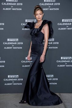 46bd14a55199 Gigi Hadid wore a Zac Posen Fall 2018 gown at the red carpet ahead of the  2019 Pirelli Calendar launch gala at HangarBicocca on December 2018 in  Milan