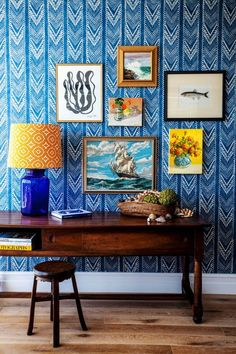 Bright wallpapers in cheerful colours also works well in helping to define the space. Pair it with a mix of family vacation photographs and whimsical art prints to create a gallery wall in your entryway. Image courtesy, Kara Rosenlund for Halcyon House