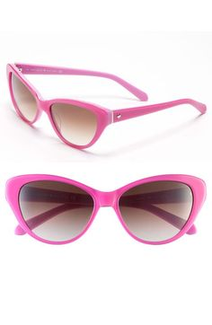 These Kate Spade #sunglasses are Classic cat's-eye. The contours get kicked up a notch in bright pink for fun sunglasses accented with a polished spade on one temple