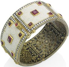 An Indian seed pearl, ruby and diamond bracelet. The bangle composed of five hinged panels, each with applied seed pearl decoration and five foilbacked cabochon rubies, set within a border of brilliant-cut diamonds, to the enameled sides and interior of pierced floral design, mounted in yellow gold, inner circumference 17.0cm. Via Diamonds in the Library.