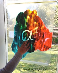 finger painting for kids who don't like the feeling of paint on their hands- could be a table activity with enough plastic