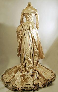 Wedding Dress.  Date: 1884. Culture: American. Medium: silk, cotton. Dimensions: (a) Length at CB: 15 1/2 in. (39.4 cm). (b) Length at CB: 75 in. (190.5 cm).