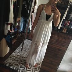 gorgeous spring maxi dress Pretty sheer maxi dress made with chiffon. Halter top and open back. Lace inlet in the bottom. Would be best over a bathing suit or because it's sheer. Fits a little small Dresses Maxi