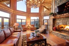 Good Rustic North Georgia House In Mountain Cabin Living Room Decor Stone Wall Fireplace Accent Arm Chair With Ottoman Wood Floor Laminate Reclainer Sofa Red Leather Sofa Side Table Floral Rug Lamp Cabin Living Room Design Ideas Western Living Rooms, Cozy Living Rooms, Living Room Kitchen, Living Room Decor, Dining Room, Western Style, Western Decor, Winter Living Room, Family Room Design