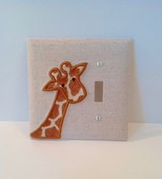 This light switch cover features a light oatmeal colored background fabric, and its then appliquéd with a sweet giraffe design. Please choose whether you want the giraffe to be on the left or right of the light switch (shown to the left of the light switch.) Please add any special requests to the notes section when you check out.  I also have a coordinating night light and lamp shade listed in the shop!  The light switch cover measures 4 1/2 square, and the monogram can be placed either ...