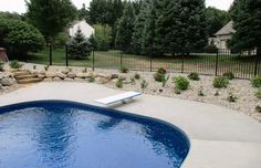 black ornamental aluminum swimming pool fence by Ultra Aluminum Aluminum Pool Fence, Metal Fence, How To Wear Ankle Boots, Michigan, Swimming Pools, Black Fence, Yard, Outdoor Decor, Pools