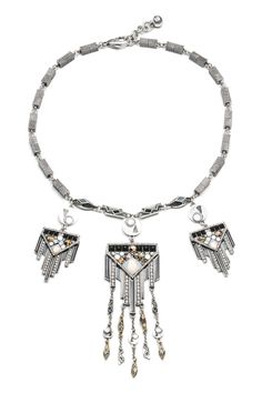 "By Lula Frost - This statement necklace features silver and gold plated metal, opal, and clear glass stones. This item measures at 19""(L) with 1"" extension."