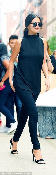 Selena Gomez recently showed how black skinny jeans can still look dressy when worn with heels and a chic top