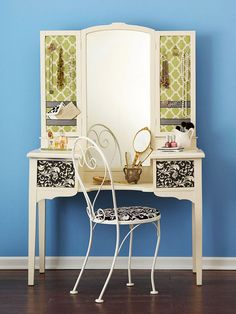 Shabby to Chic Vanity  Think twice before dismissing a throwback piece such as this vintage vanity. Bits of fabric and scrapbook paper transform this traditional dressing table into a chic collectable that provides plenty of space to display jewelry, nail polish, and perfumes