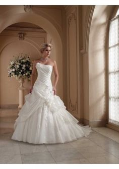 Organza Strapless Neckline With Floral Accent Bias Pleated Bodice Asymmetrically Dropped Waistline Ruffled Overskirt With Appliq