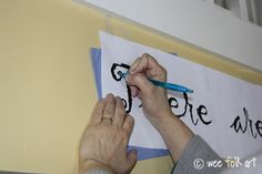 """Paint words on the wall; """"wax free tracing paper"""" seems to be the key. http://weefolkart.com/content/writing-wall-how"""