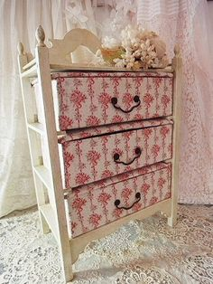Fabric baskets on shelves and edging at the top - perfect for a small child.