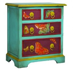 We love the vintage vibe from this turquoise and purple chest with brightly colored butterflies. #dressers #nursery