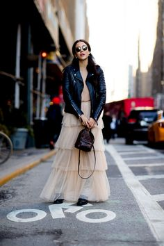 Pairing a black leather biker jacket with a beige tulle maxi skirt is a comfortable option for running errands in the city. A pair of black leather lace-up flat boots will seamlessly integrate within a variety of outfits.   Shop this look on Lookastic: https://lookastic.com/women/looks/biker-jacket-crew-neck-sweater-maxi-skirt/24140   — Black Leather Biker Jacket  — Tan Crew-neck Sweater  — Beige Tulle Maxi Skirt  — Dark Brown Leather Backpack  — Black Leather Lace-up Flat Boots