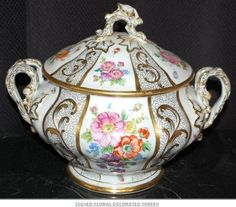 Signed floral decorated tureen.