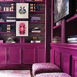 Atlanta Homes & Lifestyles - dens/libraries/offices - jewel toned room, jewel tones, plum color, glossy plum color, glossy plum-pink color, glossy cabinetry, inkblot carpet, abstract patterned rug, high gloss cabinetry, library, art in front of bookcases, wallpaper lining shelves, wallpaper backing bookshelves, styled bookcases, styled shelves, plum pink, plum, modern library, abstract art, framed abstract art, upholstered stools, plum upholstered stools, jewel toned upholstered stools…