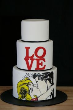 "This is such an awesome cake! I wouldn't necessarily even need pop art on it. Maybe just the ""LOVE"" lettering and some sparse red hearts on the top and bottom layers. I love cake, so love on a cake is perfect. I don't love cake like that kid from American Pie loves apple pie, though."