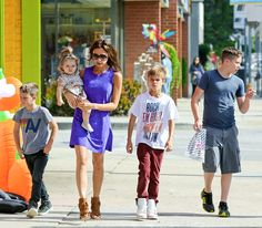 Victoria Beckham went shopping for Halloween costumes with kids Cruz,Harper,Romeo and Brooklyn on Oct.7,2012