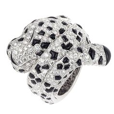CARTIER Diamond and Onyx Panther Ring | From a unique collection of vintage fashion rings at http://www.1stdibs.com/jewelry/rings/fashion-rings/