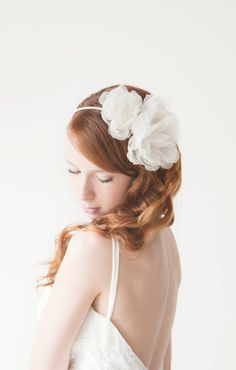 "This listing is for a Bridal or Special occasion Hairpiece. This piece called ""Forever Love"" and is a very light and sheer hair piece.     The flowers are made with a very high quality silk ivory organza fabric. They are completely hand cut and shaped by hand. In the inside there are three...    $72"