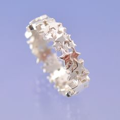 Star Cluster 6mm Wide - love this ring! The designer is Chris Parry - follow him on Pinterest!